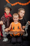 The boys and girl wearing halloween costumes Stock Photo