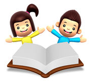 A boys and girls in the big book reading Royalty Free Stock Photo