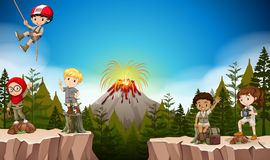Boys and girls camping in the mountain Stock Image