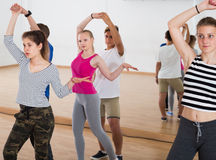 Boys and girls dancing foxtrot Stock Photos