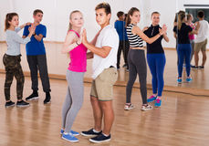 Boys and girls dancing rumba Stock Images