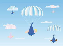 Boys and girls go down on parachutes Royalty Free Stock Photo