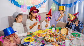 Boys and girls happy to see each other during Christmas dinner Royalty Free Stock Photography