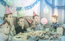 Boys and girls happy to see each other during Christmas dinner Stock Images