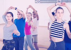 Boys and girls having dancing class in dance studio Royalty Free Stock Image