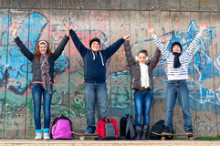 Boys and girls having fun on the street. Happy teenage boys and girls having fun in urban environment after the school royalty free stock photo