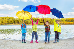Boys and girls holding umbrellas Royalty Free Stock Photography