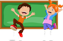 Boys and girls jumping in front of a blackboard Royalty Free Stock Image