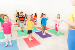 Boys and girls jumping with skipping rope in gym Royalty Free Stock Images