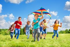 Boys and girls with kite stock images