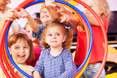 Boys and girls look though hoops Royalty Free Stock Photo