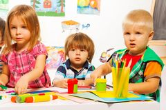 Boys and girls painting Royalty Free Stock Photos
