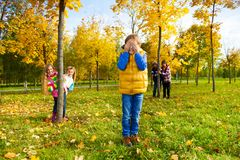 Boys and girls play hide and seek Royalty Free Stock Photos