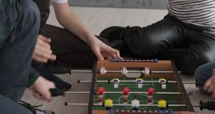 Children playing foosball game at home stock video footage