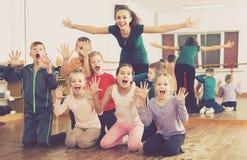 Boys and girls posing. European boys and girls posing in dance hall Stock Photos