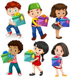 Boys and girls with present boxes Stock Images