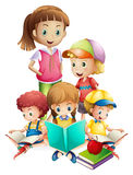 Boys and girls reading book Royalty Free Stock Photography
