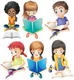 Boys and girls reading books Stock Photo