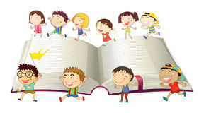 Boys and girls running on book Royalty Free Stock Photography