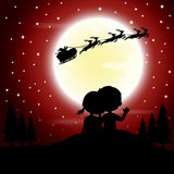 Boys and girls see Santa Claus riding a sleigh pulled by reindeer. Vector illustration of boys and girls see Santa Claus riding a sleigh pulled by reindeer with Stock Photography