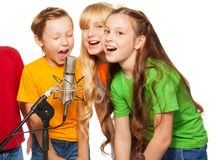 Boys and girls singing. In microphone Stock Images