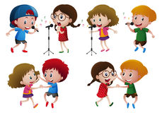 Boys and girls singing and dancing Stock Photos