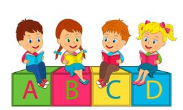 Boys and girls sit on the cubes and read the book Stock Images