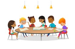 Boys and girls sitting around round table, studying, reading books and discuss them. Kids talking to each other at