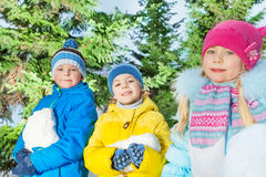 Boys and girls with snow in the park Royalty Free Stock Photo
