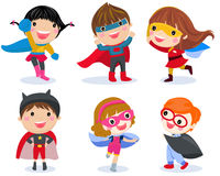 Boys and girls in superhero costumes on white background Royalty Free Stock Image