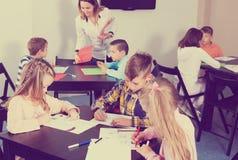Boys and girls with teacher Royalty Free Stock Photos