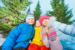 Boys and girls together close portrait in winter stock photography