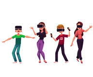 Boys and girls wearing virtual reality headsets, simulators, devices Stock Photography