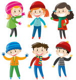 Boys and girls in winter outfit Royalty Free Stock Photos