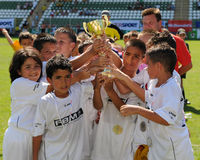 Boys are glad. KAPOSVAR, HUNGARY - JULY 24: The second-place german players are glad at the V. Youth Football Festival Under 9 Final - Atletico Arad (ROM) vs FC royalty free stock photos
