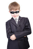 Boys with glass. Close-up of boy in business suit. Shot in studio. Isolated with clipping path Royalty Free Stock Photos
