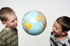 Boys globe Royalty Free Stock Photo
