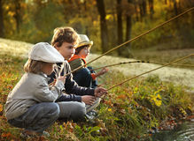 boys go fishing on the river Stock Image