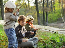 Boys go fishing on the river Royalty Free Stock Photography
