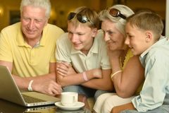 Boys with grandparents  and laptop Royalty Free Stock Photos