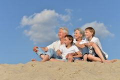 Boys with grandparents on the sand Royalty Free Stock Photography