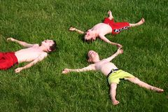 Boys in Grass. Boys laying in grass having a great time laughing Stock Photography
