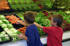 Boys in Grocery Store Royalty Free Stock Photography