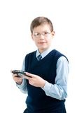 Boys hand playing portable video game Stock Photography