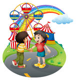 Boys handshaking in front of the carnival Stock Photos