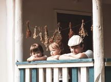 Boys happy on the porch of an old house. Three boys happy on the porch of an old house royalty free stock photos