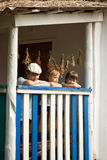 Boys happy on the porch of an old house Royalty Free Stock Image