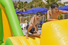 The Boys  are Have Fun in the Aqua Park Stock Photo