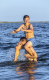 Boys have fun playing piggyback Stock Photography
