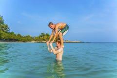 Boys have fun playing piggyback Stock Photography